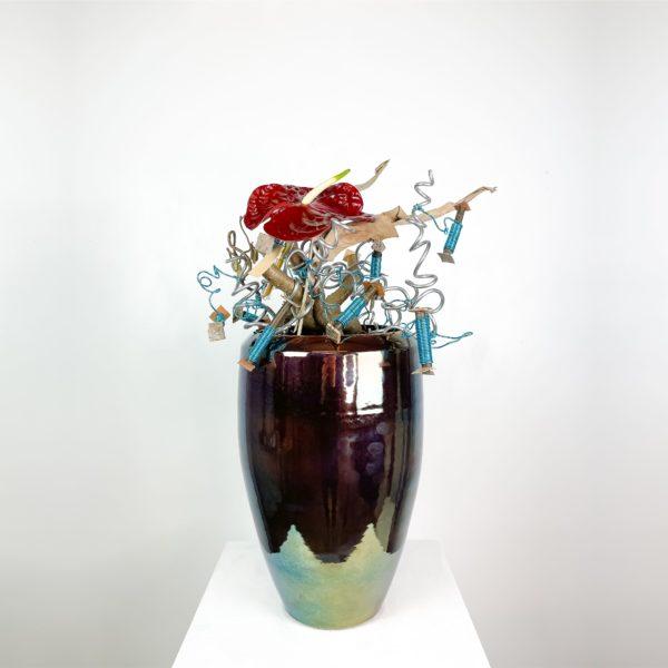 Vaso moback rami di nocciolo, provette e fiore di anthurium   Andrea Patrizi Flower Shop
